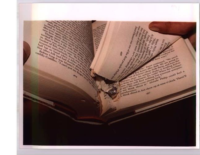 open book with torn pages