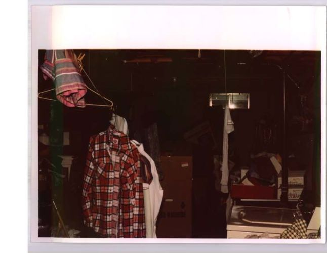 storage area with clothes hanging